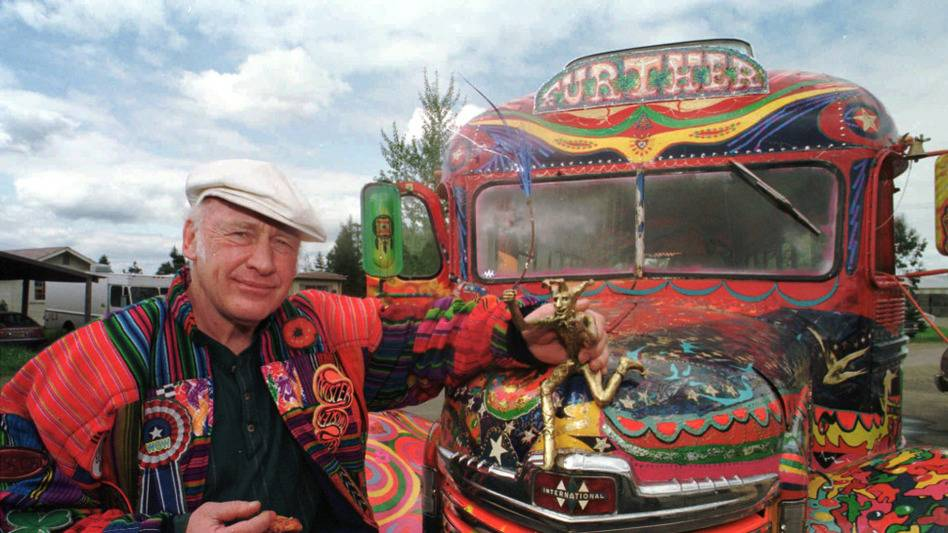 """Author Ken Kesey poses in 1997 with his bus, """"Further,"""" a descendant of the vehicle that carried Kesey and the Merry Pranksters on the 1964 trip immortalized in Tom Wolfe's book The Electric Kool-Aid Acid Test. Kesey, who died in 2001, is the subject of the new documentary Magic Trip."""